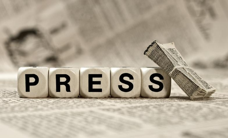 Press article stock image, the word PRESS spelt out with dice