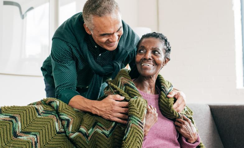 Man caring for older woman