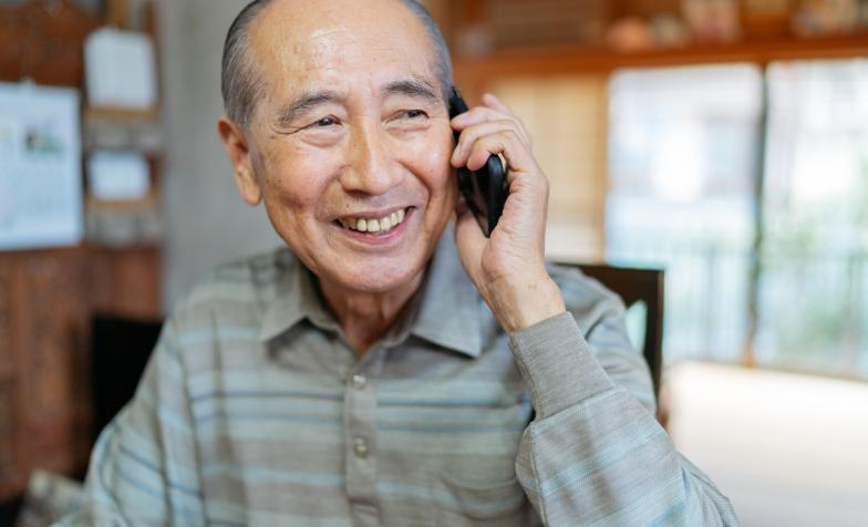 Older Asian man on phone