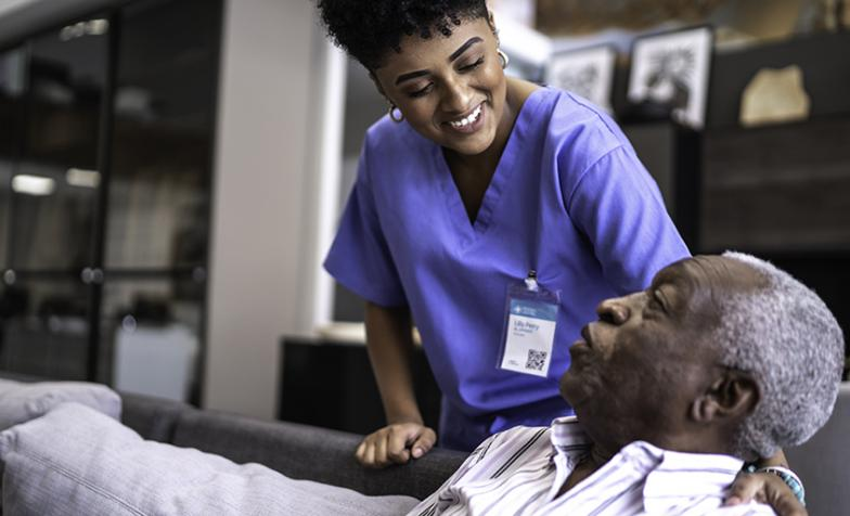 A nurse making sure that their patient is comfortable and happy