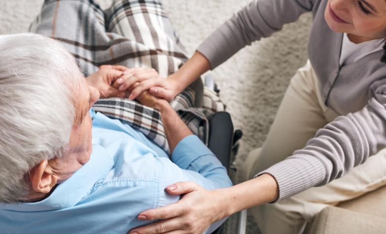 Female carer and elderly man