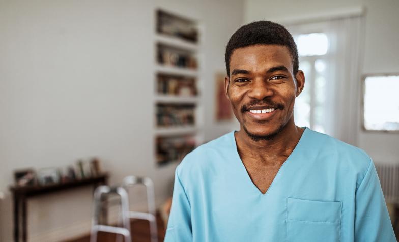 Hospice care nurse smiling towards the camera