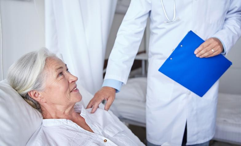 Hospice worker attending patient