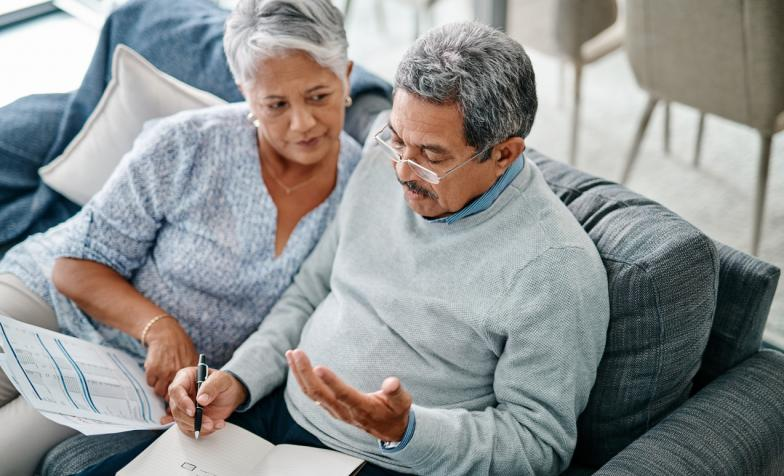 Elderly couple writing a will together