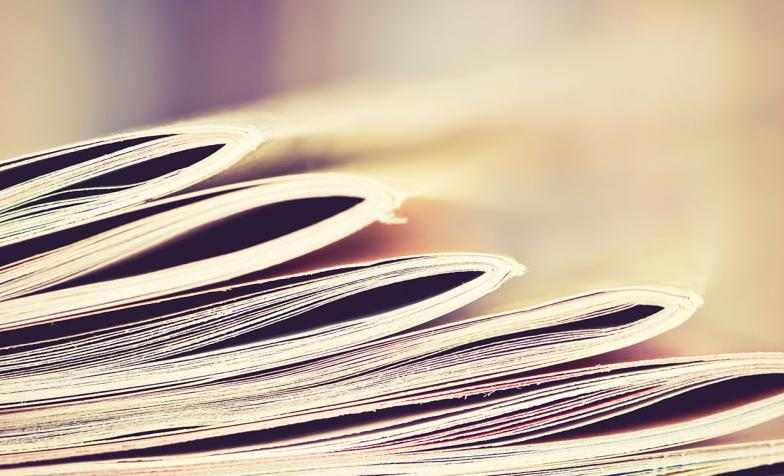 Stock photo of publications piled up on top of each other