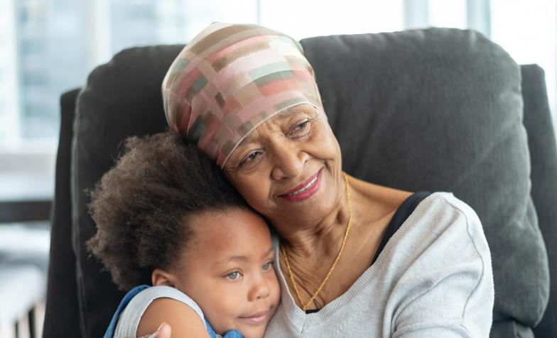 Grandmother holds her young granddaughter