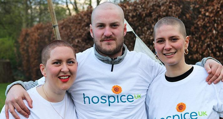 Photo of three people who braved a headshave for Hospice UK
