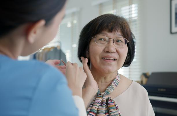 Woman talking to a care worker