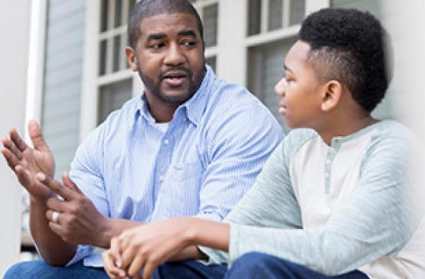 Father with boy having a conversation