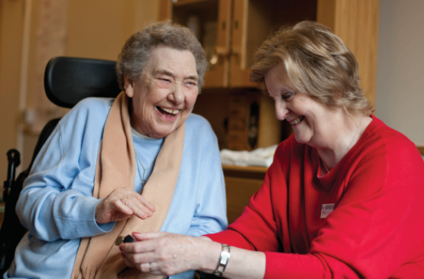 Older woman laughing with friend
