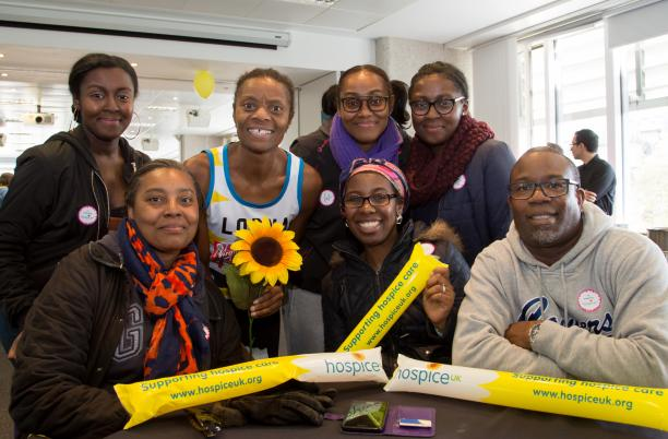 A group of Hospice UK supporters at the London Marathon with sunflowers