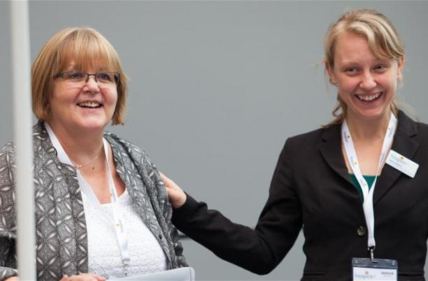 Two members of Hospice UK staff at the National Conference