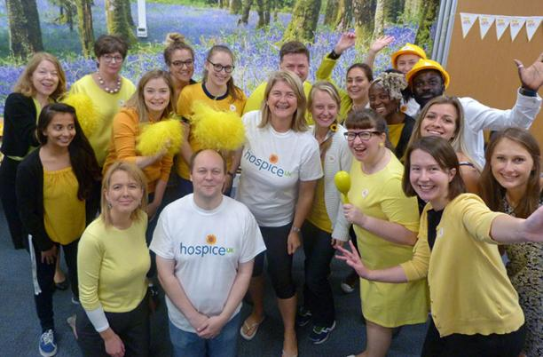 Hospice UK staff celebrating a Go Yellow event in 2017