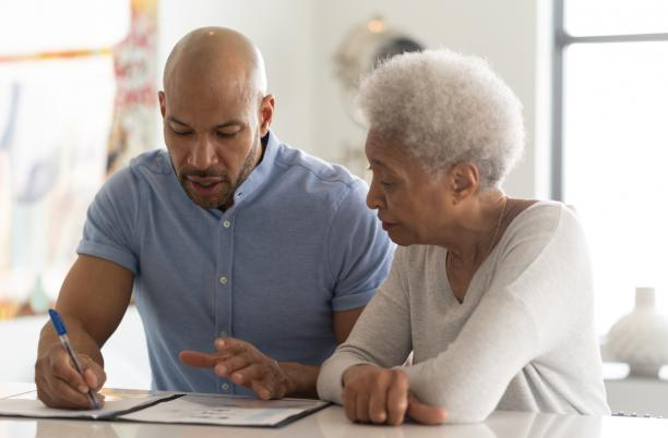 Older woman with son writing a will
