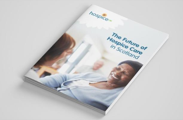 Hospice UK report lying at an angle on a table