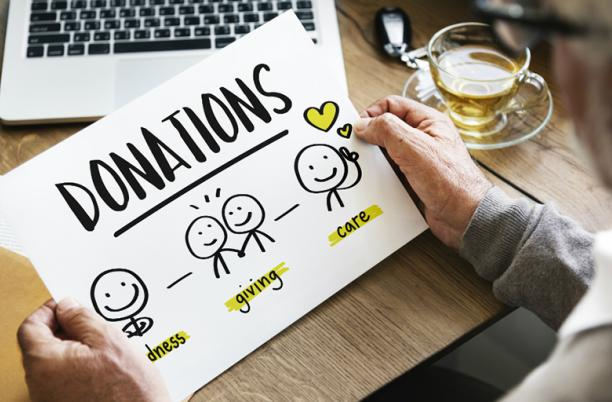 A stock image of someone looking at a sheet promoting donations