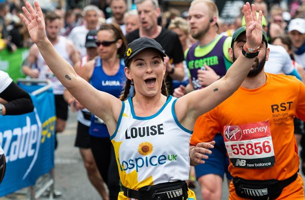 Louise, one of our team of 2019 London Marathon runners, waving at the Cutty Sark