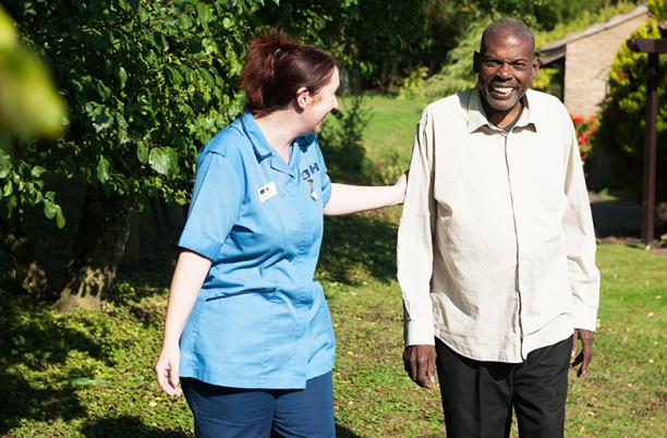 A photo of a hospice nurse at St Clare Hospice in Essex supporting a patient