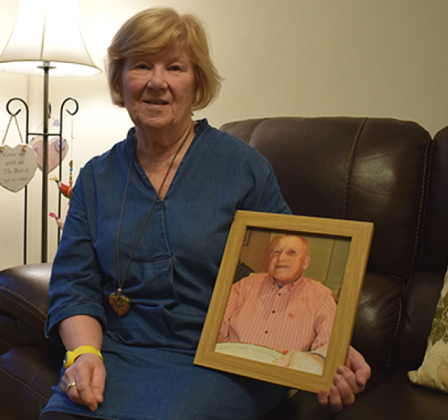Margaret, holding a picture of her husband Gordon