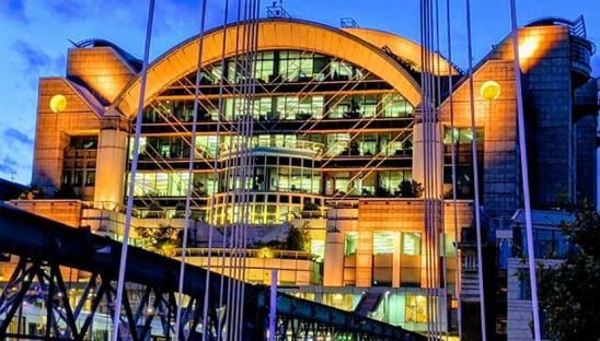 PwC building lit up for Go Yellow 2019