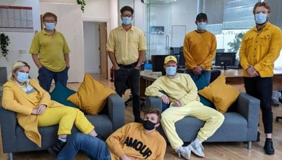 Staff at Raffolux wearing yellow for Hospice Care Week